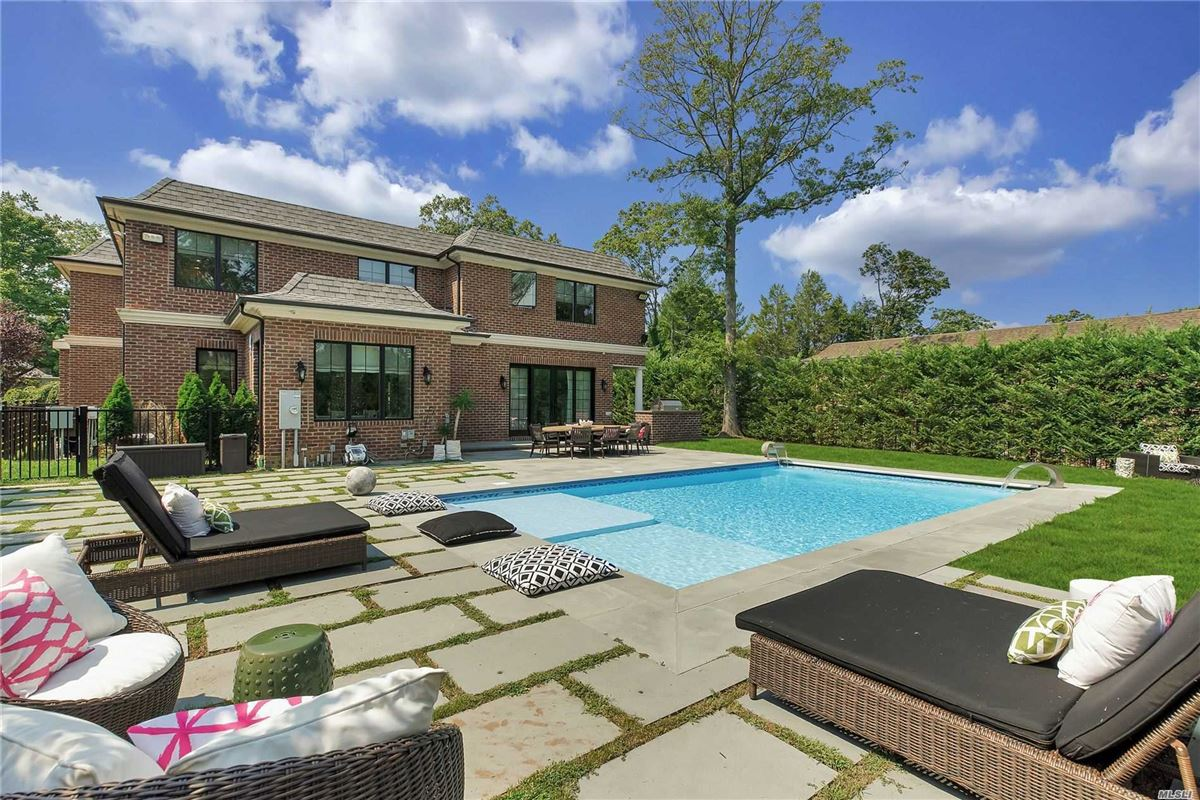 Luxury homes in elegant and timeless all brick center hall colonial