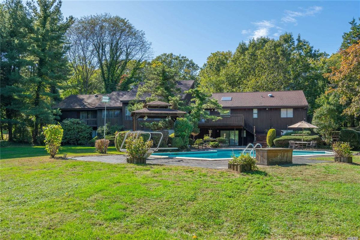 Mansions in 1979 contemporary on over two acres in Stone Arches