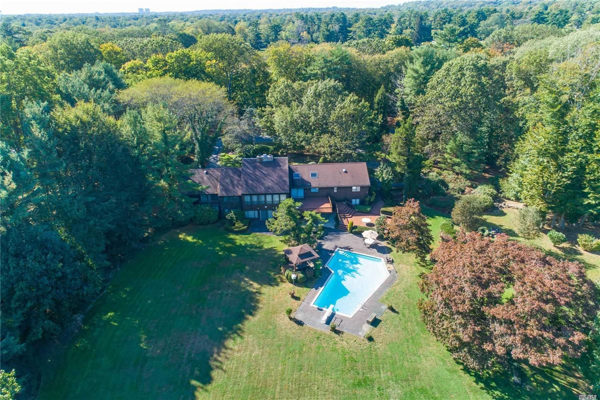 1979 contemporary on over two acres in Stone Arches  luxury homes