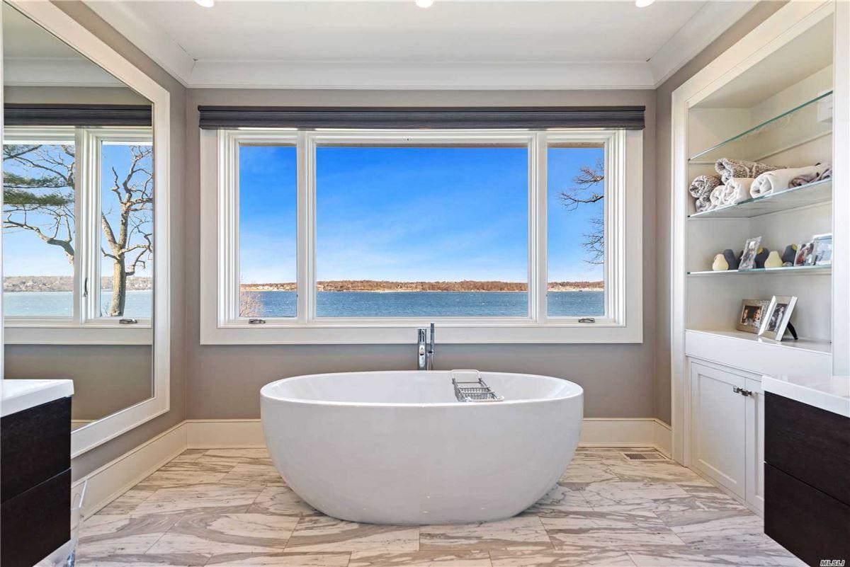 Luxury properties Newly rebuilt Hampton style waterfront home