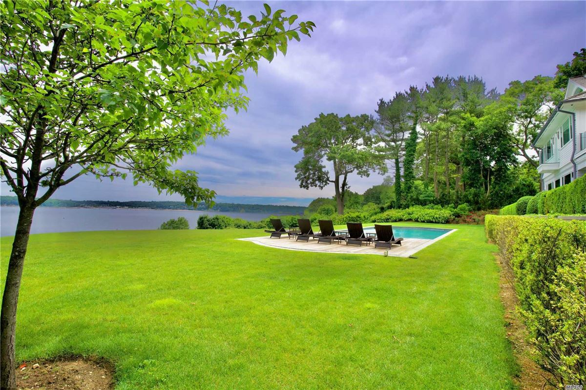 Newly rebuilt Hampton style waterfront home luxury homes