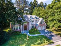 Majestic center hall brick and stucco young Tudor luxury homes