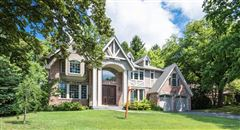Luxury real estate Majestic center hall brick and stucco young Tudor
