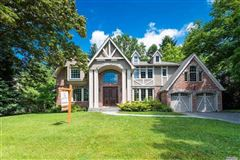 Majestic center hall brick and stucco young Tudor luxury real estate