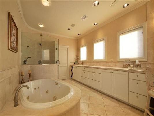 Luxury homes in Impressivecustom home on a prominent corner lot