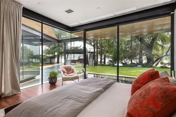 Mansions in extensive remodel in a Zen-like lakeside setting