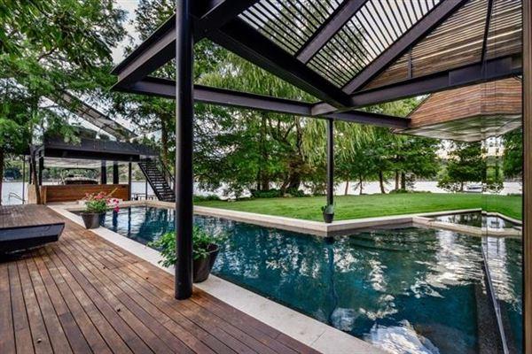 extensive remodel in a Zen-like lakeside setting luxury homes