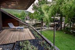 Luxury properties extensive remodel in a Zen-like lakeside setting