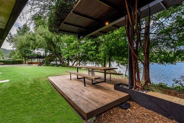 extensive remodel in a Zen-like lakeside setting mansions