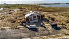 Luxury properties stunning custom home has amazing west facing views