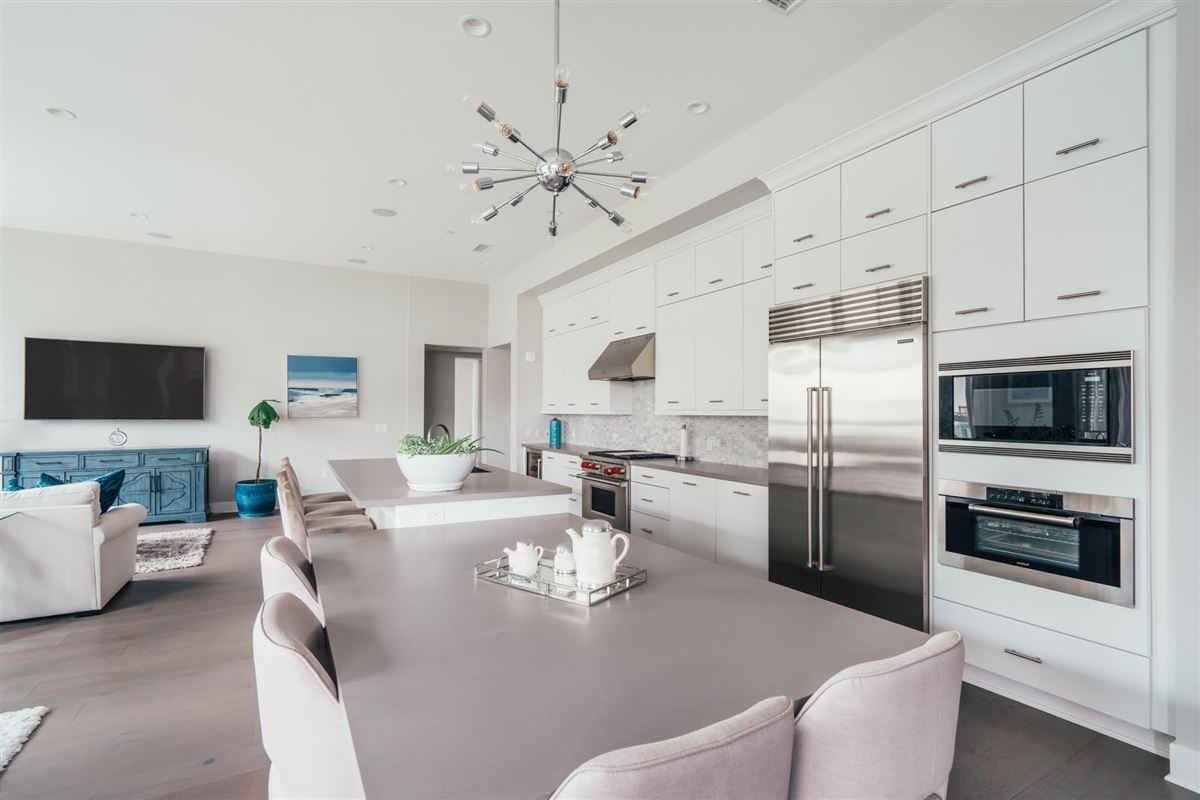 Mansions beautifully designed top floor single level condo at CLEO