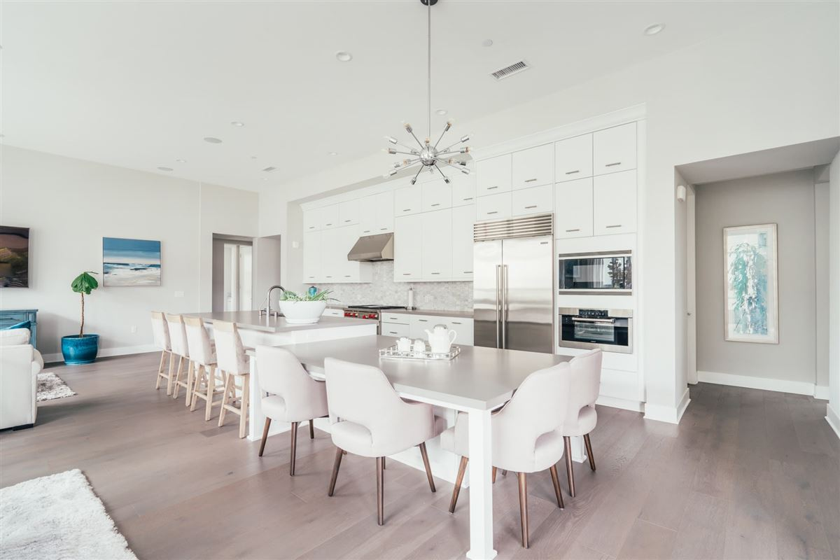 Mansions in beautifully designed top floor single level condo at CLEO