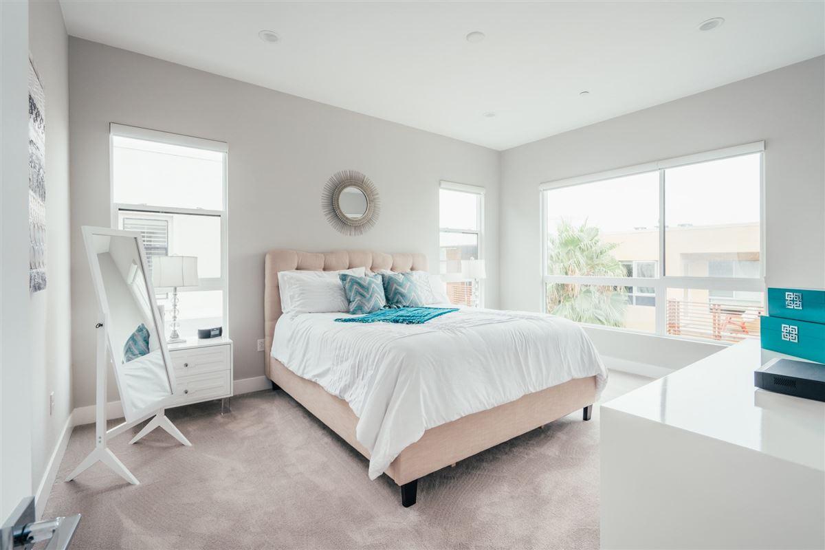 beautifully designed top floor single level condo at CLEO luxury homes