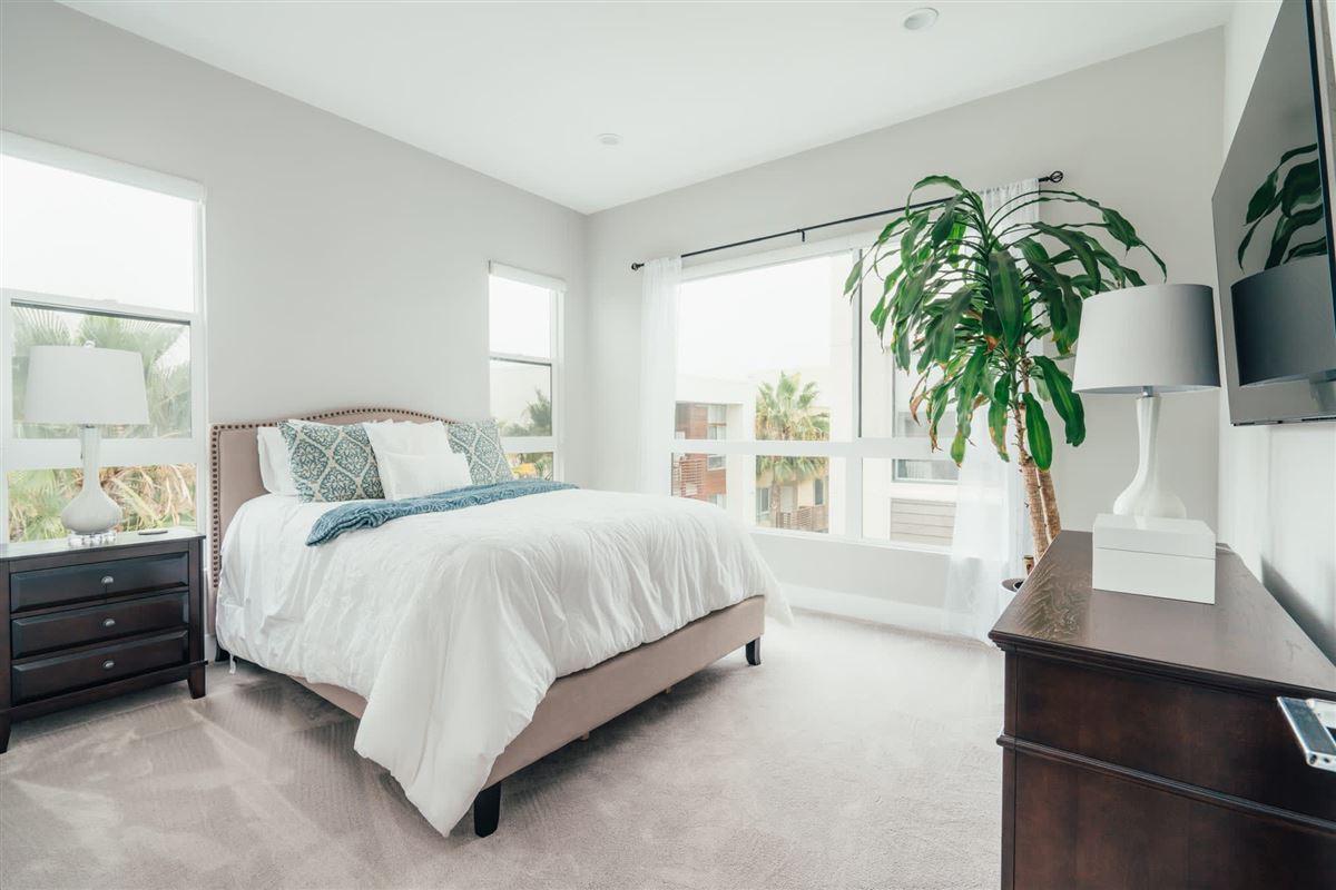 Luxury real estate beautifully designed top floor single level condo at CLEO