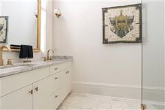 Mansions exceptionally renovated and restored first floor condo
