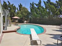 Luxury properties lovely property boasts a large private yard with pool