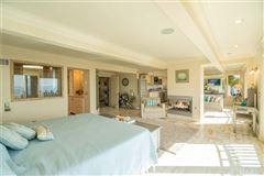 Luxury homes in this exquisite beach front home boasts grand views
