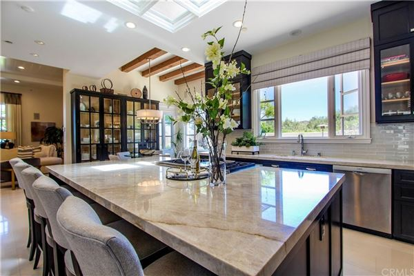 One Pelican Hill Circle is a stylish and modern home within the Pelican Hill luxury homes