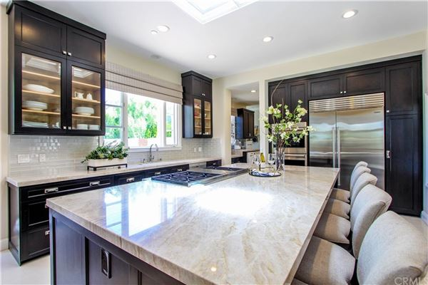 Luxury real estate One Pelican Hill Circle is a stylish and modern home within the Pelican Hill