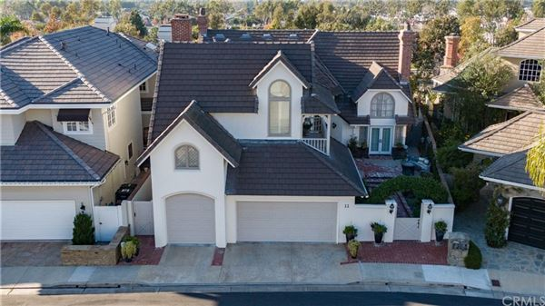 This custom built home is a jewel in the prestigious and private gated community of Harbor Hill mansions