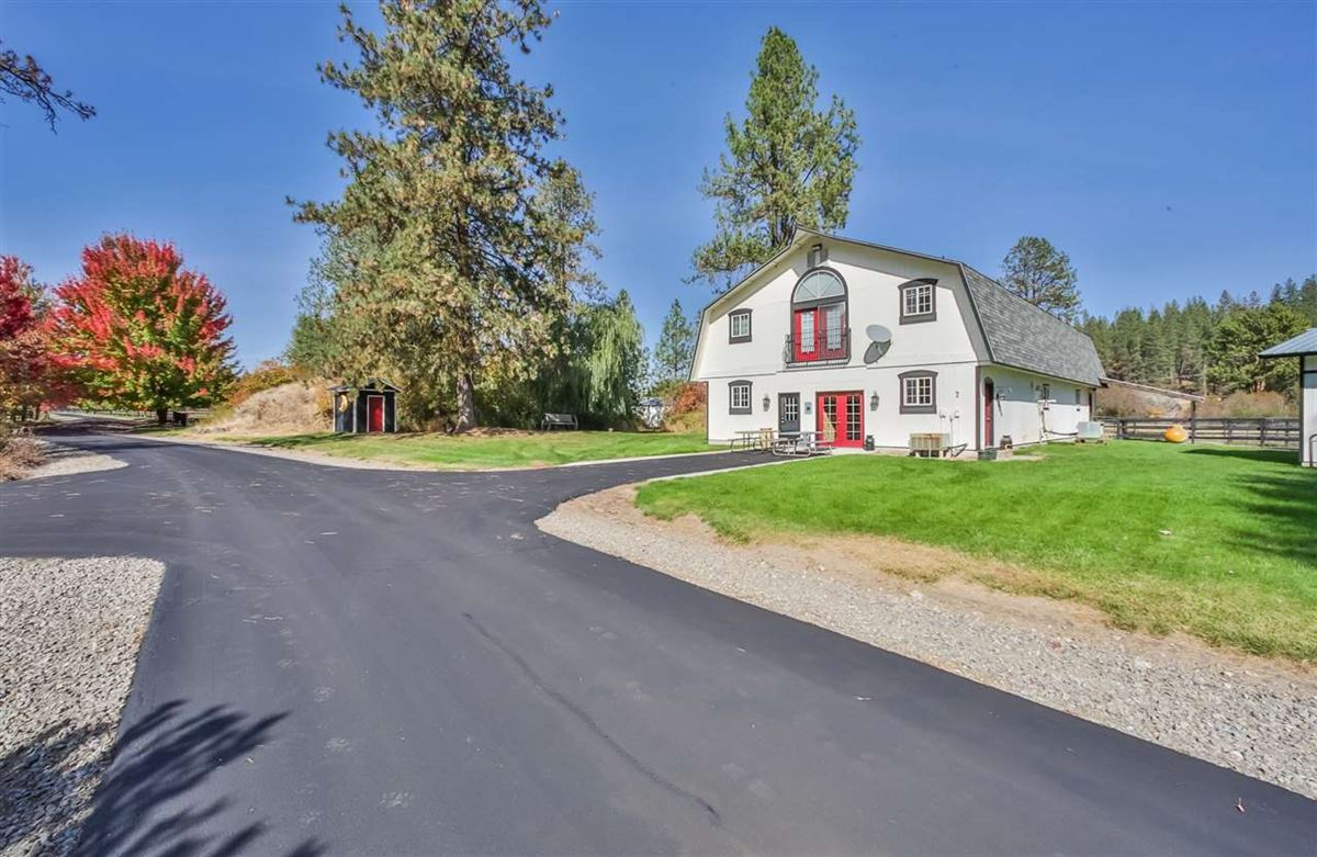 Mansions in Little Spokane River frontage