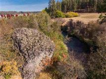 Little Spokane River frontage  luxury properties