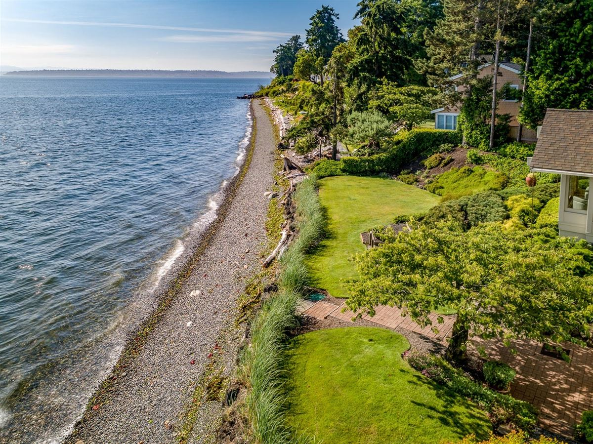 Mid-Century Waterfront Masterpiece in Wing Point luxury properties