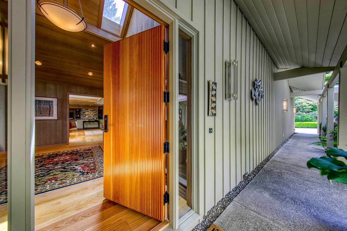 Mid-Century Waterfront Masterpiece in Wing Point mansions