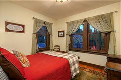 Mansions in restored vintage estate-like property