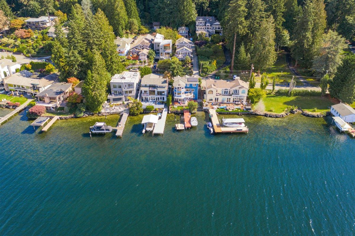 Luxury homes in Storybook sunny west-facing waterfront