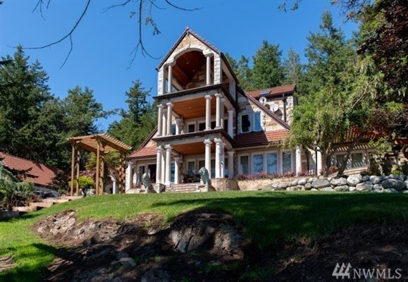 SECLUDED WATERFRONT STONE MANSION luxury homes