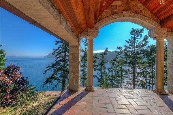 SECLUDED WATERFRONT STONE MANSION luxury properties