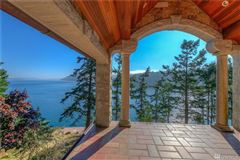 SECLUDED WATERFRONT STONE MANSION luxury real estate