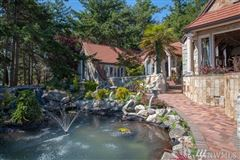 Mansions in SECLUDED WATERFRONT STONE MANSION