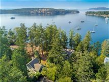 Secluded Craftsman style waterfront home mansions