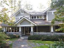 Secluded Craftsman style waterfront home luxury homes