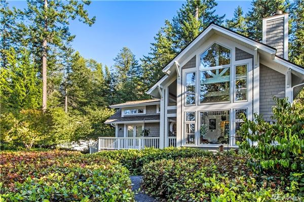 Secluded Craftsman style waterfront home luxury real estate