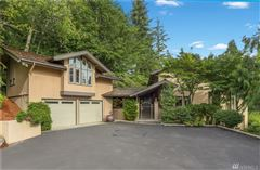 Luxury homes in Rare gated estate with lake and city views