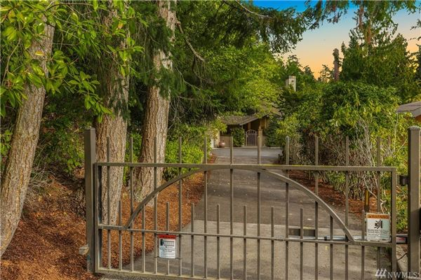 Mansions Rare gated estate with lake and city views