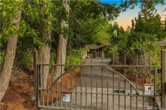 Rare gated estate with lake and city views luxury real estate