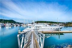 Luxury homes in waterfront skyline rambler