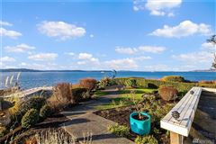 quintessential Northwest home on coveted Alki Point luxury homes