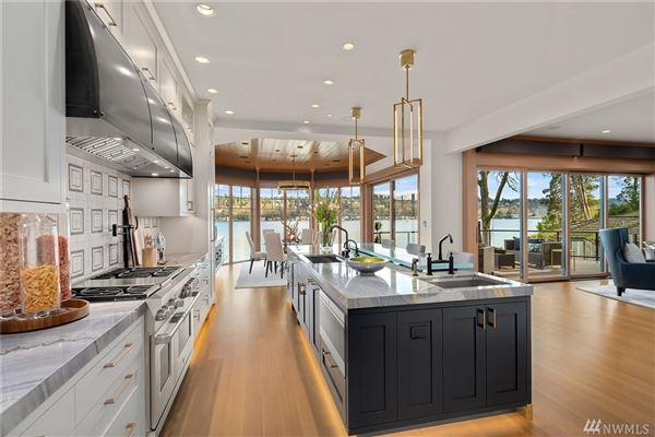 Timeless and Refined low bank waterfront home luxury homes