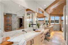 Timeless and Refined low bank waterfront home luxury real estate