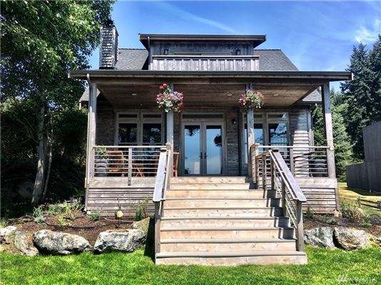 Newer craftsman home on beautiful waterfront mansions