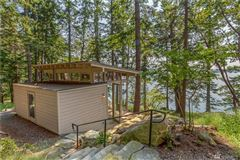 Luxury homes in CONTEMPORARY BLAKELY IS WATERFRONT COMPOUND