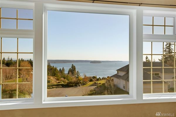 Luxury homes in premier home with views of rainier and puget sound from nearly every room