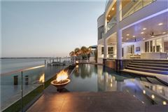 Mansions in modern work of art on the water