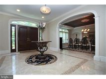 Luxury homes in rare Inverness stone and stucco Colonial