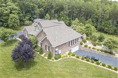 Exceptional custom-built brick home on 30 acres luxury properties